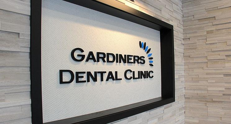 sign of Gardiners Dental Clinic inside hallway