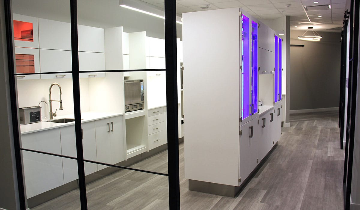 sterilization room with white cabinets in dental office